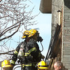 """North Metro Fire Rescue firefighters enter  a house on fire on Weld County Rd. 11 north of Weld County Rd. 4 in Broomfield on Thursday. The resident of the home was not injured. <br /> For more photos please see  <a href=""""http://www.broomfieldenterprise.com"""">http://www.broomfieldenterprise.com</a><br /> January 23, 2012<br /> staff photo/ David R. Jennings"""