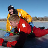 "North Metro Fire Rescue District firefighter Ben Freedman helps guide  ""victim"" Matt Horan along the ice during Monday's ice rescue training session at Croke Reservoir in Northglenn. <br />  <br />  <br /> January 25, 2010<br /> Staff photo/David R. Jennings"