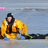 "North Metro Fire Rescue District firefighter Ben Freedman pulls the ""victim"", made from fire hose,along the ice during Monday's ice rescue training session at Croke  Reservoir in Northglenn. <br />  <br />  <br /> January 25, 2010<br /> Staff photo/David R. Jennings"