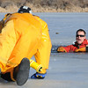 Firefighter Rob Williams, right, playing the victim, yells as rescuer Ben Freedman during North Metro Fire Rescue District's ice rescue training session on Monday at Croke  Reservoir in Northglenn. <br />  <br />  <br /> January 25, 2010<br /> Staff photo/David R. Jennings
