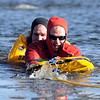 North Metro Fire Rescue District  Engineer John Daugherty, left, rescues firefighter Randy Delaney during Monday's ice rescue training session at Croke  Reservoir in Northglenn. <br />  <br />  <br /> January 25, 2010<br /> Staff photo/David R. Jennings