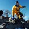 Firefighter Ben Freedman, North Metro Fire Rescue District, climbs down rocks to begin a rescue during Monday's ice rescue training session at Croke  Reservoir in Northglenn. <br />  <br />  <br /> January 25, 2010<br /> Staff photo/David R. Jennings