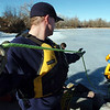 Engineer Jason Crownover, North Metro Fire Rescue District, pulls the rope during Monday's ice rescue training session at Croke  Reservoir in Northglenn. <br />  <br />  <br /> January 25, 2010<br /> Staff photo/David R. Jennings