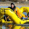 Ben Freedman left, is hauled with fellow firefighters out of the water and ice in the new rescue boat during Monday's North Metro Fire Rescue District ice rescue training session at Croke  Reservoir in Northglenn. <br />  <br />  <br /> January 25, 2010<br /> Staff photo/David R. Jennings