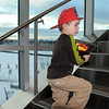 Nicholan Kastner, 4, climbs the stairs of the new North Metro Fire Rescue District administration building carrying the North Metro Fire calender open to a fire that happened next to his school last year during Thursday's public open house.<br /> <br /> January 20, 2011<br /> staff photo/David R. Jennings