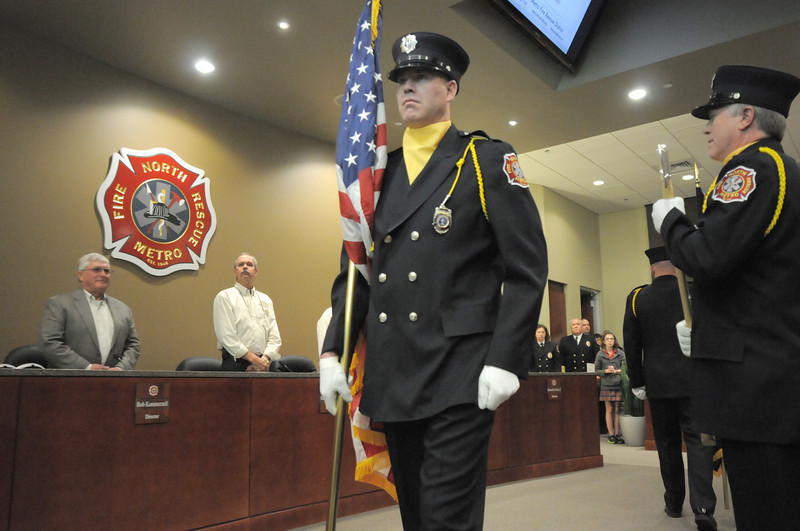 Lt. John Dougherty presents the colors with the North Metro Fire Honor Guard during the public open house of the new North Metro Fire Rescue District administration building on Thursday.<br /> <br /> January 20, 2011<br /> staff photo/David R. Jennings