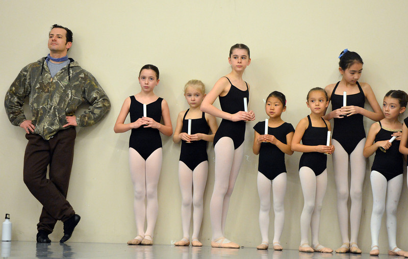 Brandon Freeman, left, and student dancers wait to perform during rehearsal for Ballet Nouveau Colorado's production of the Nutcracker on Saturday at the studio.<br /> <br /> December 1, 2012<br /> staff photo/ David R. Jennings