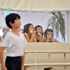 Ballet students watch the rehearsal for Ballet Nouveau Colorado's production of the Nutcracker from a window on Saturday at the studio.<br /> <br /> December 1, 2012<br /> staff photo/ David R. Jennings