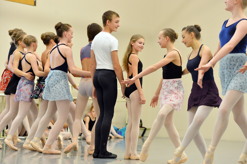 Skylar Greenwald and Valerie Warkins, center, portraying the Nutcracker and Clara as other dancers move around them during rehearsal for Ballet Nouveau Colorado's production of the Nutcracker on Saturday at the studio.<br /> <br /> December 1, 2012<br /> staff photo/ David R. Jennings