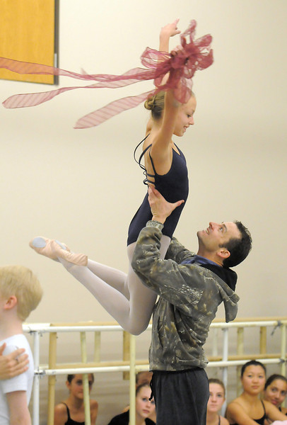 Brooke Gilliam, 13, playing Clara, is lifted in the air by Brandon Private Freeman playing her father in the party scene during rehearsal for Ballet Nouveau Colorado's Nutcracker at the studio on Saturday.<br /> <br /> November 26, 2011<br /> staff photo/ David R. Jennings