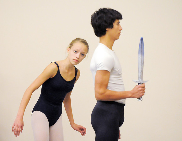 Brooke Gilliam, 13, left, playing Clara, looks around Antonio Houck, 14, playing the Nutcracker during rehearsal for Ballet Nouveau Colorado's Nutcracker at the studio on Saturday.<br /> <br /> November 26, 2011<br /> staff photo/ David R. Jennings