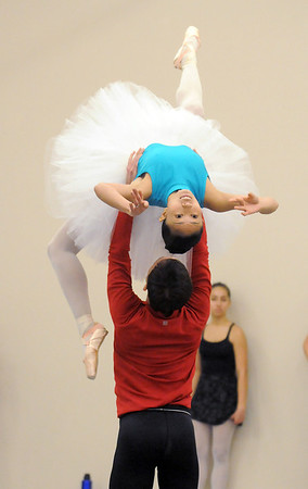 Marian Faustino and Ben Delony perform a dance during rehearsal for Ballet Nouveau Colorado's Nutcracker at the studio on Saturday.<br /> <br /> November 26, 2011<br /> staff photo/ David R. Jennings