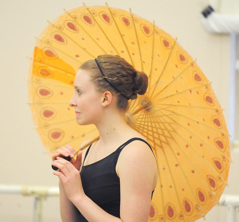 Kathleen Smith, 14, spins a parasol for the Chinese Dance during rehearsal for Ballet Nouveau Colorado's Nutcracker at the studio on Saturday.<br /> <br /> November 26, 2011<br /> staff photo/ David R. Jennings