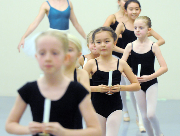 Tahlia Fish, 7, center, dances as one of the angels during rehearsal for Ballet Nouveau Colorado's Nutcracker at the studio on Saturday.<br /> <br /> November 26, 2011<br /> staff photo/ David R. Jennings