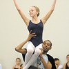 Brooke Gilliam, 13, is carried by Damien Patterson playing Drosselmeyer during rehearsal for Ballet Nouveau Colorado's Nutcracker at the studio on Saturday.<br /> <br /> November 26, 2011<br /> staff photo/ David R. Jennings