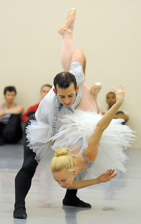 Sarah Tallman and Brandon Private Freeman perform the dance of the Sugar Plum Fairy during rehearsal for Ballet Nouveau Colorado's Nutcracker at the studio on Saturday.<br /> <br /> November 26, 2011<br /> staff photo/ David R. Jennings