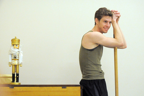Colby Foss waits next to the Nutcracker prop before his dance during rehearsal for Ballet Nouveau Colorado's Nutcracker at the studio on Saturday.<br /> <br /> November 26, 2011<br /> staff photo/ David R. Jennings