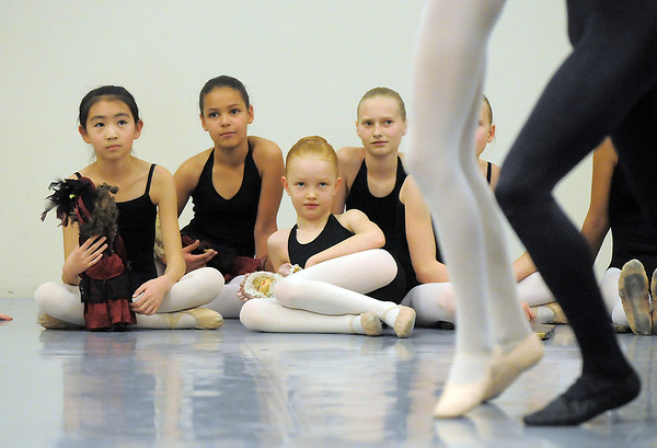 Student dancers watch the professional dancers perform during rehearsal for Ballet Nouveau Colorado's Nutcracker at the studio on Saturday.<br /> <br /> November 26, 2011<br /> staff photo/ David R. Jennings