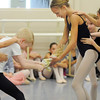 Brooke Gilliam, 13, right, as Clara, and Parker Long, 11, as Clara's brother Fritz, fight over the Nutcracker during rehearsal for Ballet Nouveau Colorado's Nutcracker at the studio on Saturday.<br /> <br /> November 26, 2011<br /> staff photo/ David R. Jennings