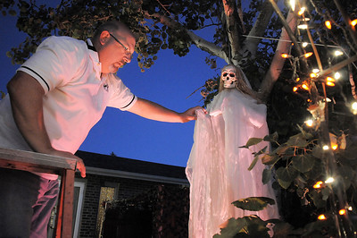 """Jim O'Dell makes adjustments on a skeleton while working on Halloween decorations, transforming his home into his haunted house dubbed """" The Chilling Hour""""  at 920 Coral St. on Wednesday.   October 19, 2011 staff photo/ David R. Jennings"""