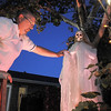 "Jim O'Dell makes adjustments on a skeleton while working on Halloween decorations, transforming his home into his haunted house dubbed "" The Chilling Hour""  at 920 Coral St. on Wednesday.  <br /> October 19, 2011<br /> staff photo/ David R. Jennings"