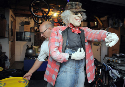 """Jim O'Dell move a dummy he made for his Halloween haunted house dubbed """" The Chilling Hour""""  at 920 Coral St. on Wednesday.  O'Dell will transform the garage to a room on the haunted. October 19, 2011 staff photo/ David R. Jennings"""