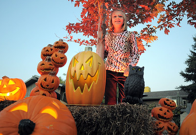 """Emma O'Dell, 9, poses among pumpkin Halloween decorations at her family's haunted house dubbed """" The Chilling Hour""""  at 920 Coral St. on Wednesday.  Emma is going to be a vampire for the haunted house. October 19, 2011 staff photo/ David R. Jennings"""