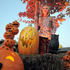 "Emma O'Dell, 9, poses among pumpkin Halloween decorations at her family's haunted house dubbed "" The Chilling Hour""  at 920 Coral St. on Wednesday.  Emma is going to be a vampire for the haunted house.<br /> October 19, 2011<br /> staff photo/ David R. Jennings"