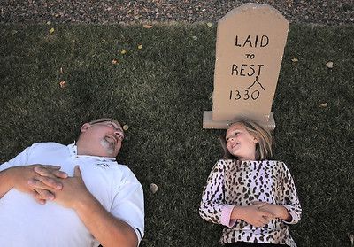 """Jim O'Dell and his daughter Emma, 9, pose in the graveyard of their Halloween haunted house dubbed """" The Chilling Hour""""  at 920 Coral St. on Wednesday.  Emma will be a vampire for the haunted house. October 19, 2011 staff photo/ David R. Jennings"""