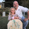 "Emma O'Dell, 9, poses with her father Jim, at the Molly Brown grave stone in the front yard of thier Halloween decorated home dubbed "" The Chilling Hour""  at 920 Coral St. on Wednesday.  Emma will be a vampire for the haunted house.<br /> October 19, 2011<br /> staff photo/ David R. Jennings"