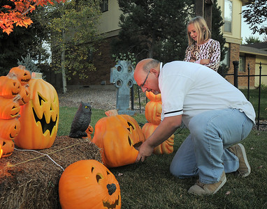 """Jim O'Dell, left, with his daughter Emma, 9, works on Halloween decorations, transforming his home into his haunted house dubbed """" The Chilling Hour""""  at 920 Coral St. on Wednesday.   October 19, 2011 staff photo/ David R. Jennings"""