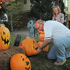 "Jim O'Dell, left, with his daughter Emma, 9, works on Halloween decorations, transforming his home into his haunted house dubbed "" The Chilling Hour""  at 920 Coral St. on Wednesday.  <br /> October 19, 2011<br /> staff photo/ David R. Jennings"