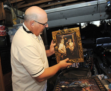 """Jim O'Dell looks at a scary painting for his Halloween haunted house dubbed """" The Chilling Hour""""  at 920 Coral St. on Wednesday.  O'Dell's garage will be transformed into a room of the haunted house. October 19, 2011 staff photo/ David R. Jennings"""