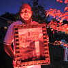 "Jim O'Dell holds a scary picture for the Halloween decorations, transforming his home into his haunted house dubbed "" The Chilling Hour""  at 920 Coral St. on Wednesday.  <br /> October 19, 2011<br /> staff photo/ David R. Jennings"