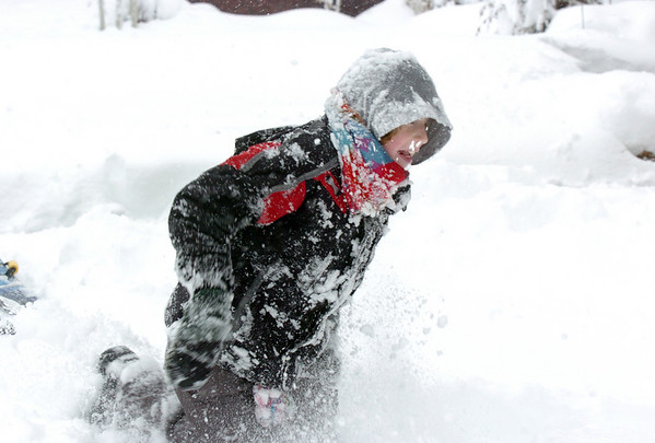 BE1101SNO15<br /> Graham Hoyle, 9, plays in the snow at his home in Lac Amora on Thursday<br /> <br /> October 29, 2009<br /> Staff photo/David R. Jennings