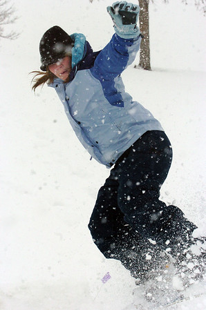 Broomfield High student Kellie Aldridge, 17, snowboards down a slope at Community Park with fellow with friends on Wednesday. Boulder Valley Schools were closed Wednesday due to the wniter storm.<br /> <br /> October 28, 2009<br /> Staff photo/David R. Jennings