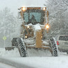 A City and County of Broomfield road grader plows 136th Avenue near Main Street during the winter storm on Wednesday<br /> <br /> October 28, 2009<br /> Staff photo/David R. Jennings