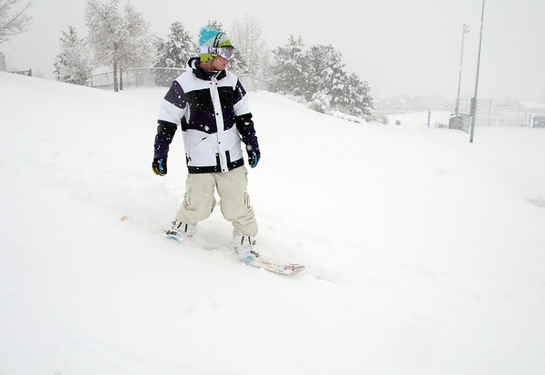 Lance Kittel, 16, snowboards down a slope at Community Park with fellow Broomfield High friends on Wednesday. Boulder Valley Schools were closed Wednesday due to the wniter storm.<br /> <br /> October 28, 2009<br /> Staff photo/David R. Jennings