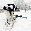 Lance Kittel, 16, buckles on his snowboard while preparing to go down a slope at Community Park with fellow Broomfield High friends on Wednesday. Boulder Valley Schools were closed Wednesday due to the wniter storm.<br /> <br /> October 28, 2009<br /> Staff photo/David R. Jennings