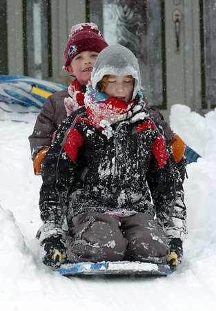 BE1101SNO13<br /> Graham Hoyle, 9, front and James Thomas, 6, sleds down Hoyle's front yard while playing in the snow in Lac Amora on Thursday<br /> <br /> October 29, 2009<br /> Staff photo/David R. Jennings