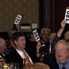 Participants making bids during the auction.<br /> <br /> October 30, 2009<br /> photo/Gerry Case