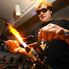 GLASSBLOWER02<br /> Miko Scott, owner of Diablo Glass, works on a piece at his studio near Nederland.<br /> <br /> Photo by Marty Caivano/Camera/Dec. 30, 2009