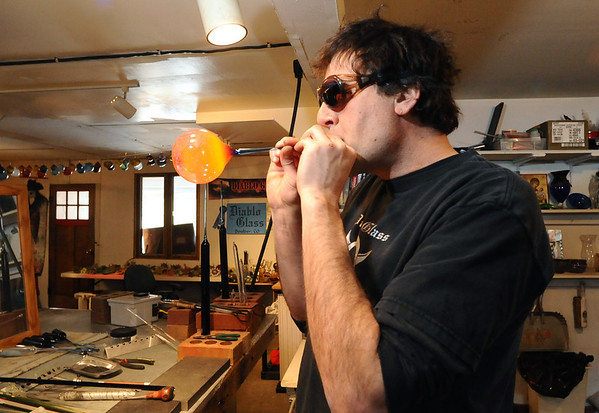 GLASSBLOWER03<br /> Miko Scott, owner of Diablo Glass, creates an orb from Pyrex at his studio near Nederland.<br /> <br /> Photo by Marty Caivano/Camera/Dec. 30, 2009