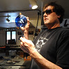 GLASSBLOWER04<br /> Miko Scott, owner of Diablo Glass, finishes the hook on a holiday ornament at his studio near Nederland.<br /> <br /> Photo by Marty Caivano/Camera/Dec. 30, 2009