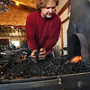 METALWORKER<br /> Metalworker David Norrie stokes his forge with coke at his studio in Berthoud. At left is one of several trees he is creating for a client.<br /> <br /> Photo by Marty Caivano/Camera/Dec. 30, 2009