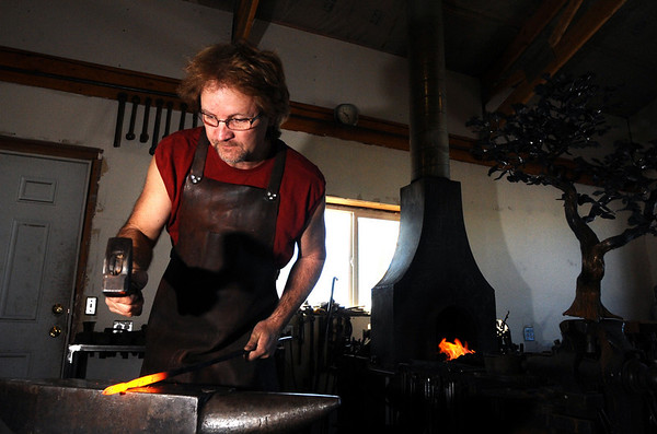 METALWORKER<br /> David Norrie flattens a steel bar into a shape that will eventually become an aspen leaf at his studio in Berthoud.<br /> <br /> Photo by Marty Caivano/Camera/Dec. 30, 2009