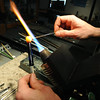 GLASSBLOWER01<br /> Miko Scott, owner of Diablo Glass, makes a bead from Pyrex at his studio near Nederland.<br /> <br /> Photo by Marty Caivano/Camera/Dec. 30, 2009