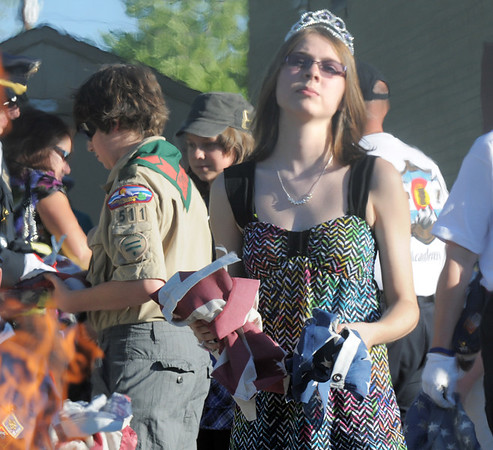 Kayla McCullough, 16, holds parts of a flag for retirement during the flag retirement ceremony at North Metro Fire station 61 on Tuesday. McCullough is wearing a tierra for her birthday.<br /> June 14, 2011<br /> staff photo/David R. Jennings