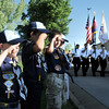Cub Scouts salute as the Broomfeild Police Honor Guard marches to begin the flag retirement ceremony at North Metro Fire station 61 on Tuesday.<br /> June 14, 2011<br /> staff photo/David R. Jennings