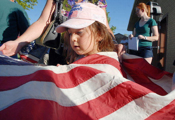 Kate Aldworth, 5, cuts the stars from a flag during the flag retirement ceremony at North Metro Fire station 61 on Tuesday.<br /> June 14, 2011<br /> staff photo/David R. Jennings